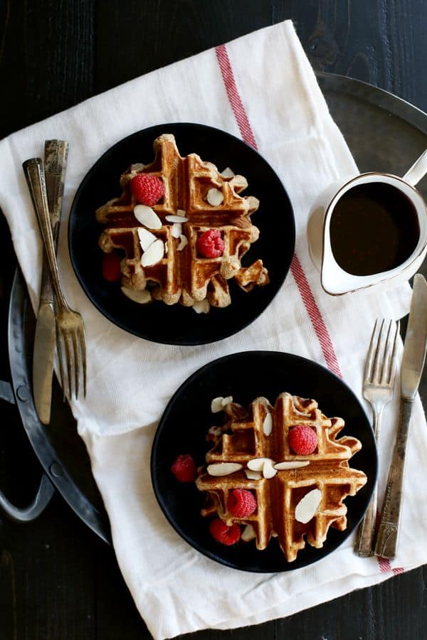 Forget boring breakfasts! These Raspberry Almond Belgian Waffles are the only way to begin your day. Soft and fluffy on the inside, crispy on the outside and swirled with raspberry amaretto preserves. In other words, perfection.
