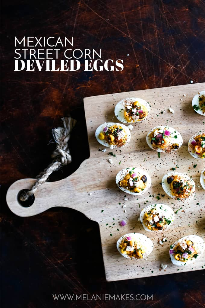 Mexican Street Corn Deviled Eggs on a wooden board.