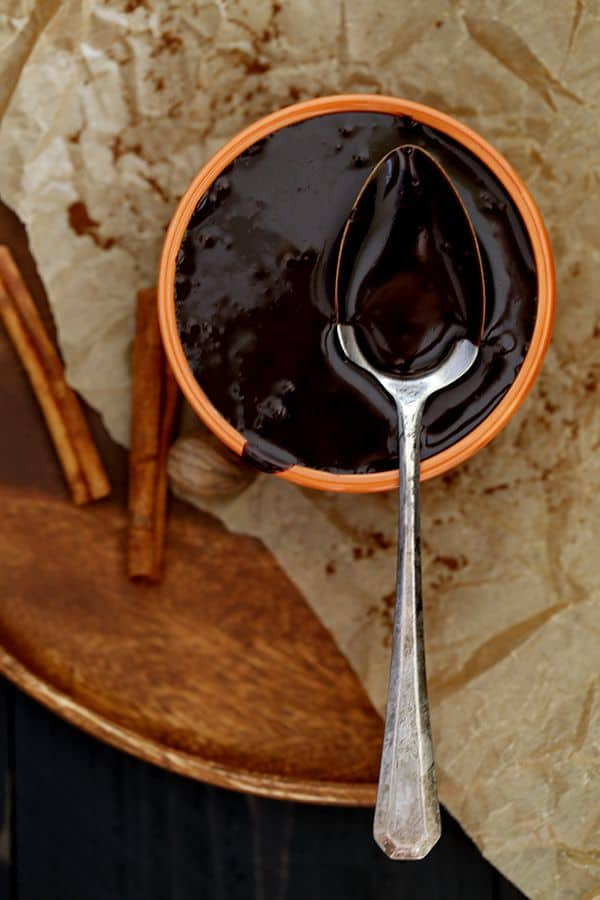This seven ingredient Pumpkin Spice Hot Fudge Sauce is spiked with all the flavors of autumn.  Cinnamon, nutmeg, clove and ginger are swirled into a velvety smooth dark chocolate sauce to create a deliciously decadent dessert topping.