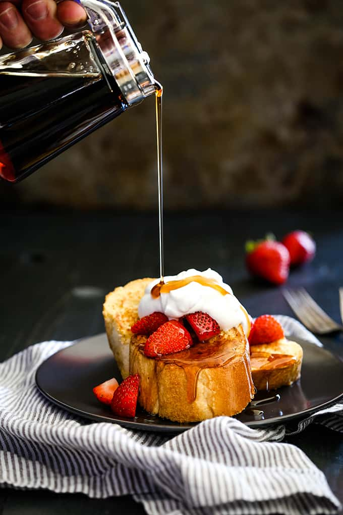 Maple syrup is drizzled onto slices of Vanilla French Toast.