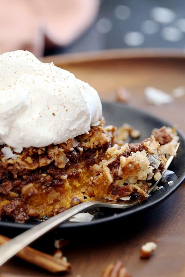 This German Chocolate Upside Down Pumpkin Pie contains all the usual spiced suspects before being showered with a German chocolate cake mix, flooded with melted butter and then sprinkled with coconut flakes and pecans.  Pumpkin.  Chocolate.  Butter.  Coconut.  Pecans.  In a nutshell, absolute deliciousness.