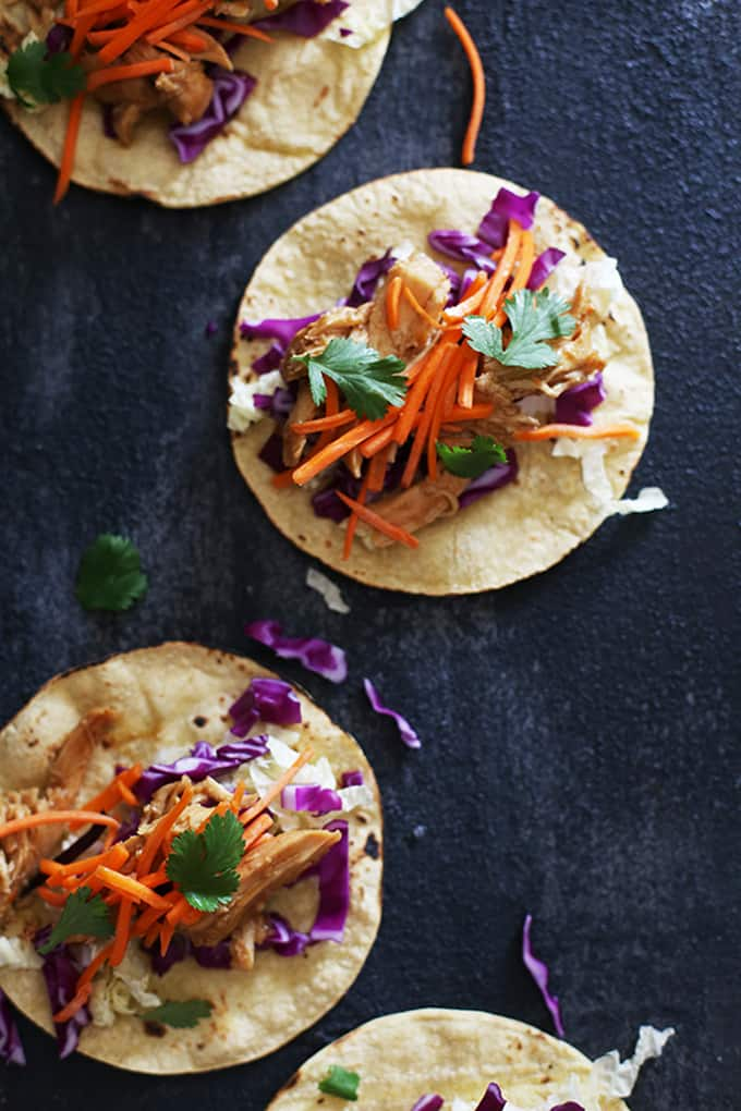 These Slow Cooker Hoisin Chili Chicken Tacos are an amazingly easy weeknight meal and the perfect way to keep Taco Tuesday the best menu of the week. Blistered corn tortillas are wrapped around succulent, Asian barbecue spiced chicken and a crunchy cabbage and carrot slaw. Make dinner even easier by letting everyone assemble their own at the table!