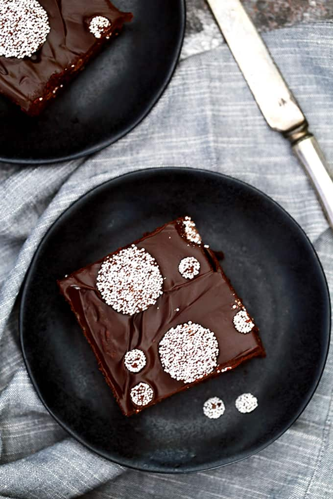 These Sno-Cap Chocolate Ganache Brownies are decadence at it's finest, my friends.  A fudgy brownie base is studded with Sno-Cap nonpareil candies before being flooded with thick layer of chocolate ganache and adorned with additional candy.
