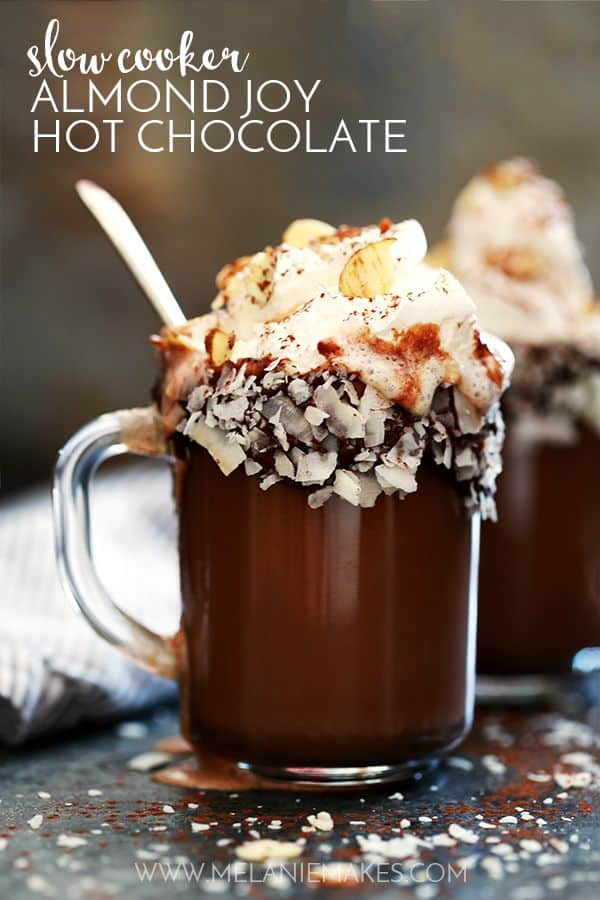 This Slow Cooker Almond Joy Hot Chocolate takes just five minutes to prepare, yet makes enough to wow a crowd! Whole milk, heavy cream, cocoa and almond extract are whisked together to form this decadently delicious treat. Garnished with whipped topping, sliced almonds and coconut flakes, this hot chocolate is easily the best around.