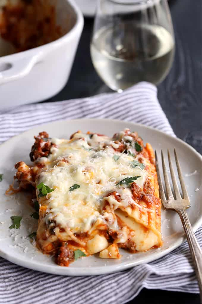 My String Cheese Manicotti is hands down the easiest way to fill manicotti!  Two pieces of string cheese are stuffed into each pasta tube before being covered with a meaty marinara sauce.  It's all then covered in another blanket of mozzarella cheese and baked until bubbly.  A garnish of chopped parsley and a shower of Parmesan cheese makes this an absolute pasta and cheese lover's delight!