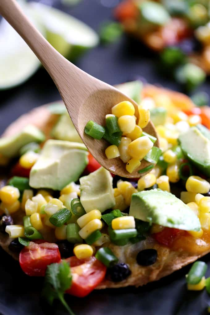 Dinner is just 20 minutes away with these bright and flavorful Black Bean Tostadas with Corn Relish.  Perfect for Meatless Monday or any day you're short on time, this recipe is easily customized and can be prepped ahead to get dinner on the table in a flash.