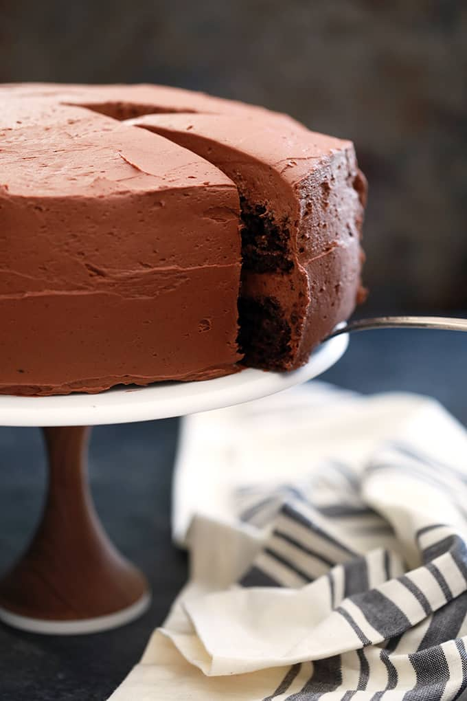 Not only is this Chocolate Pudding Fudge Cake rich, decadent and delicious but it's also incredibly easy. A store bought chocolate cake mix is dressed up with chocolate pudding, yogurt and applesauce to create the most moist chocolate cake. Using just seven ingredients, this cake is ready for the oven in under 10 minutes.