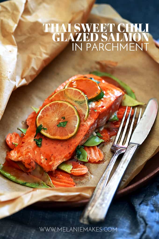 This Thai Sweet Chili Glazed Salmon in Parchment recipe is ready to eat in just 20 minutes and is more like a method of assembly than an actual of recipe. A salmon filet is placed atop a bed of carrot chips and snow peas before being garnished with slices of lime and glazed with thai sweet chili sauce before being wrapped in a parchment pocket and baked.