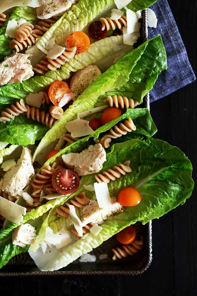 This deliciously easy Chicken Caesar Pasta Salad takes just 25 minutes to prepare and is the perfect weeknight dinner idea. Chicken, shaved Parmesan cheese, pasta and cherry tomatoes adorn crisp romaine leaves before being drizzled with a homemade Caesar dressing.