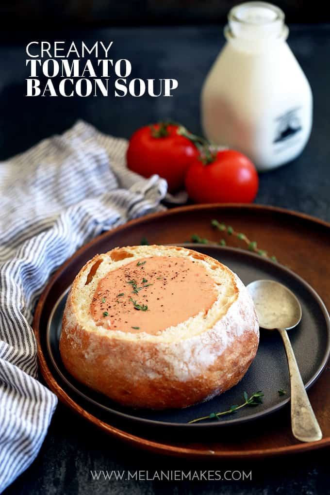 This ten ingredient Creamy Tomato Bacon Soup not only tastes amazing, but it also uses common ingredients already in your pantry and fridge.  Diced onions, bacon and garlic take a swim in melted butter before being joined with diced tomatoes, chicken broth and herbs.  An immersion blender makes quick work of making everything a near smooth consistency before it's all bathed in a shower of heavy cream.