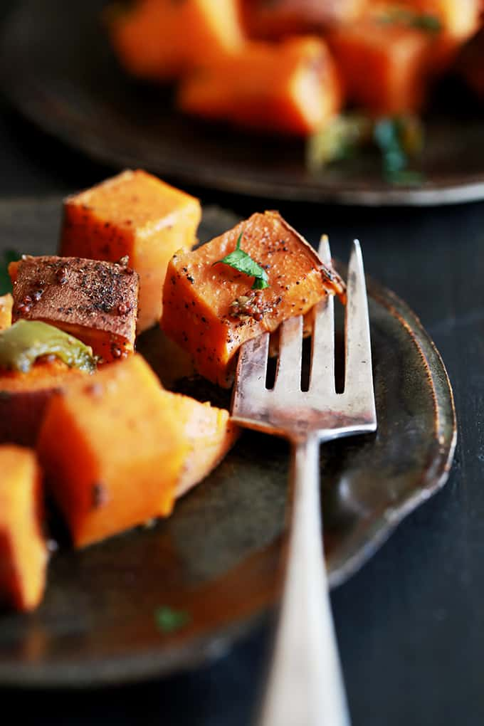 These Slow Cooker Spicy Molasses Sweet Potatoes are not only a simple side dish, but they're also a terrific meal prep shortcut.  Diced sweet potatoes are tossed with molasses, apple cider vinegar, jalapeño pepper and whole grain mustard and then slow roasted to perfection.