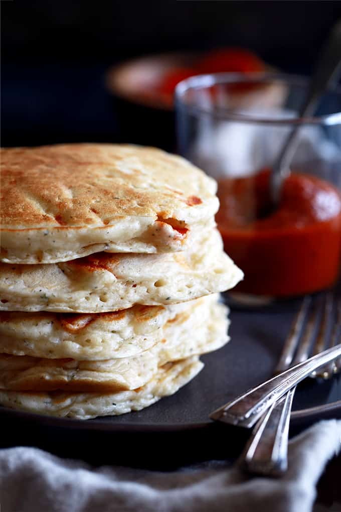 These Pepperoni Pizza Pancakes make a quick and delicious snack, lunch or dinner.  A homemade baking mix, eggs, milk and herbs are stirred together before being bedazzled with a mountain of cheese and pepperoni.  In less than 15 minutes, you've got a stack of savory flapjacks ready and waiting to be dipped into some warmed marinara sauce.