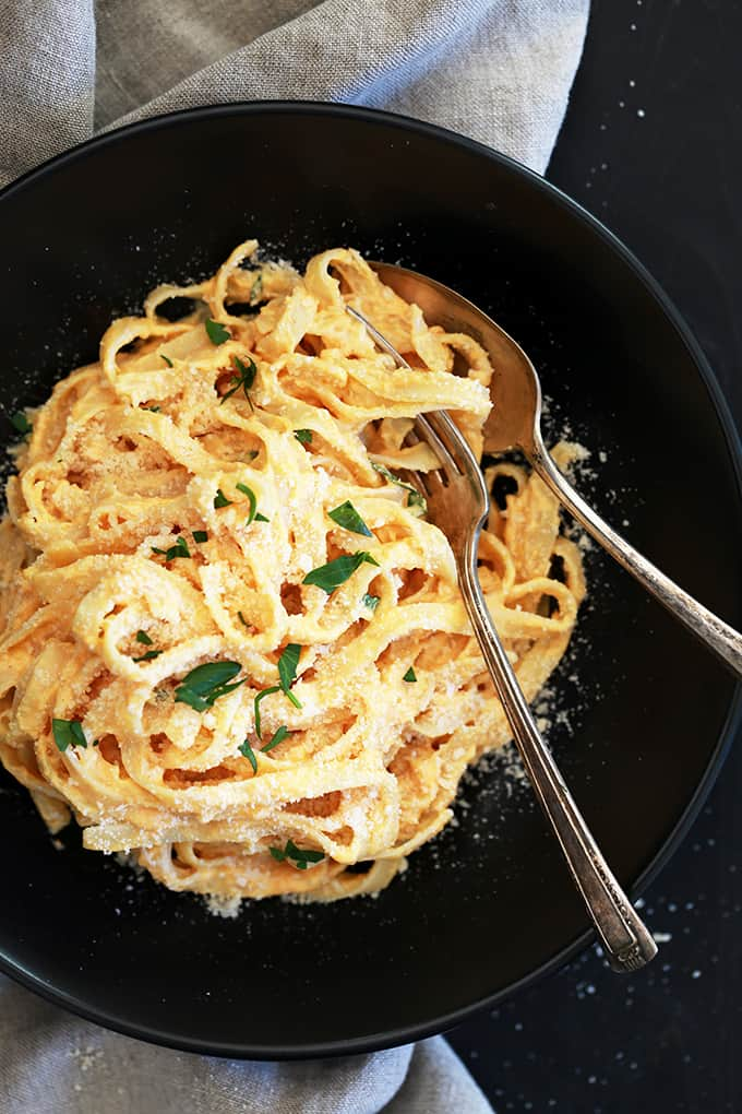 This eight ingredient Skinny Pumpkin Alfredo Sauce uses common pantry and fridge ingredients which means you can enjoy it any day of the week without making a special trip to the grocery store.  Garlic, Parmesan cheese, chicken broth and Greek yogurt are thickened into an amazing creamy sauce.  Once you stir in pumpkin puree and a sprinkle of ground nutmeg, well, an autumn pasta favorite is born.