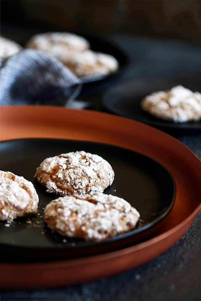 These six ingredient Caramel Pumpkin Spice Crinkle Cookies take just 20 minutes from you stirring the batter in a mixing bowl to you enjoying your first heavenly bite.  A spice cake mix is studded with caramel bits and their flavor is taken to the next level with pumpkin spice extract.  The perfect holiday flavor combination and one that is sure to be welcomed with open arms at cookie exchanges!