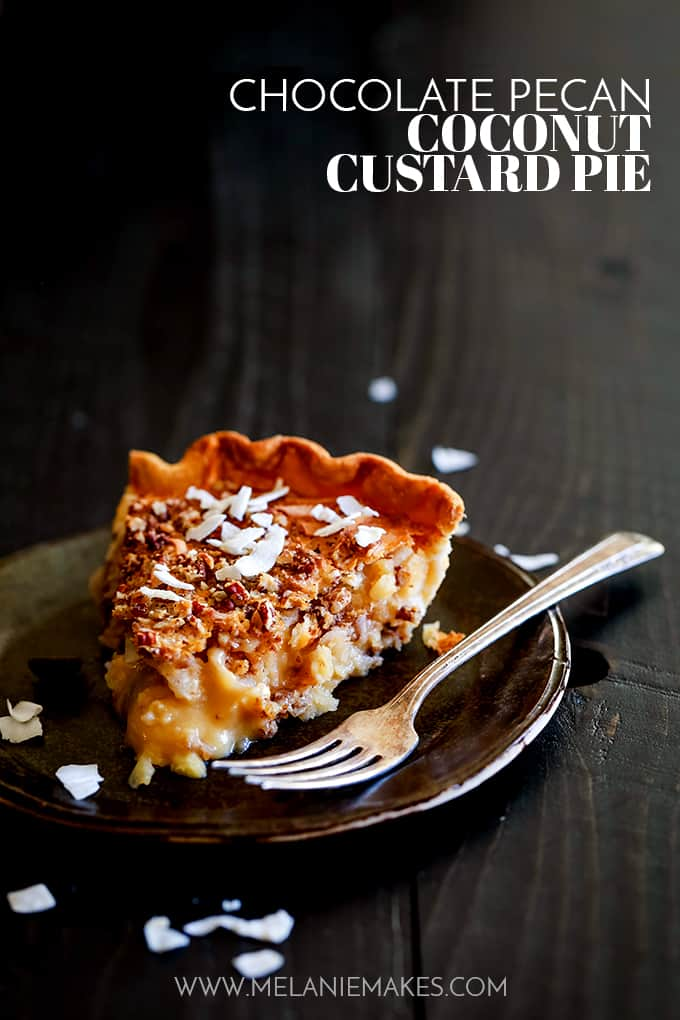 A slice of Chocolate Pecan Coconut Custard Pie on a dark colored plate with a fork on a dark background.