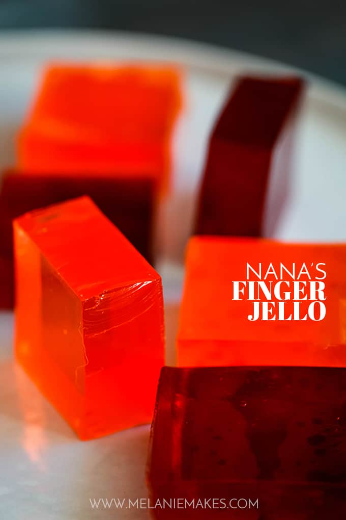 Blocks of red and orange Nana's Finger Jello on a plate.