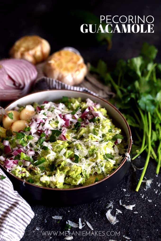 This Pecorino Guacamole begins with roasted garlic, red onion and jalapeño that are mashed with fresh avocado before being showered with Pecorino Romano cheese.  This easy guacamole recipe is then seasoned with salt and pepper and garnished with additional onion, jalapeño, parsley and a drizzle of agave nectar.