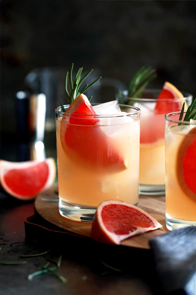 This Rosemary Greyhound Cocktail is destined to become a new favorite.  Grapefruit vodka, grapefruit juice, lime juice and rosemary simple syrup are shaken together, poured over ice and then garnished with fresh rosemary and grapefruit to create this bright and flavorful drink.