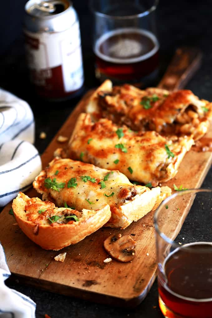 These Beef Stroganoff French Bread Toasts are perfect as a hearty appetizer for holiday get togethers or gameday or even as a family pleasing main dish.  Crispy, crunchy French bread halves are loaded with a homemade beef stroganoff mixture that's then piled high with a mountain of melty, bubbly cheese.  In short, it's the true definition of comfort food that's guaranteed to please anyone that's lucky enough to get a nibble.