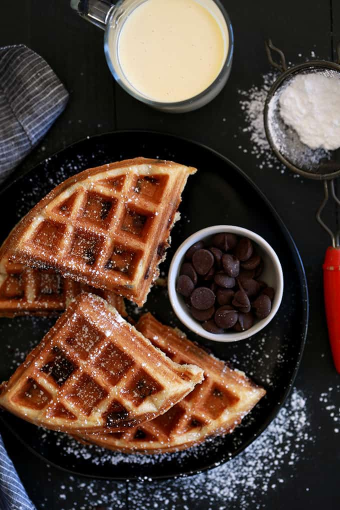 Cinnamon, vanilla, nutmeg and cloves provide the holiday flavor in these Chocolate Chip Eggnog Waffles.  But all of that delicious flavor doesn't mean extra work for you!  The eggnog provides all the flavor while the addition of yogurt to this breakfast treat makes for a waffle that's crips on the outside and light and fluffy on the inside.  Then you stir in a mountain of dark chocolate chips and, well, they're just what waffle dreams are made of!