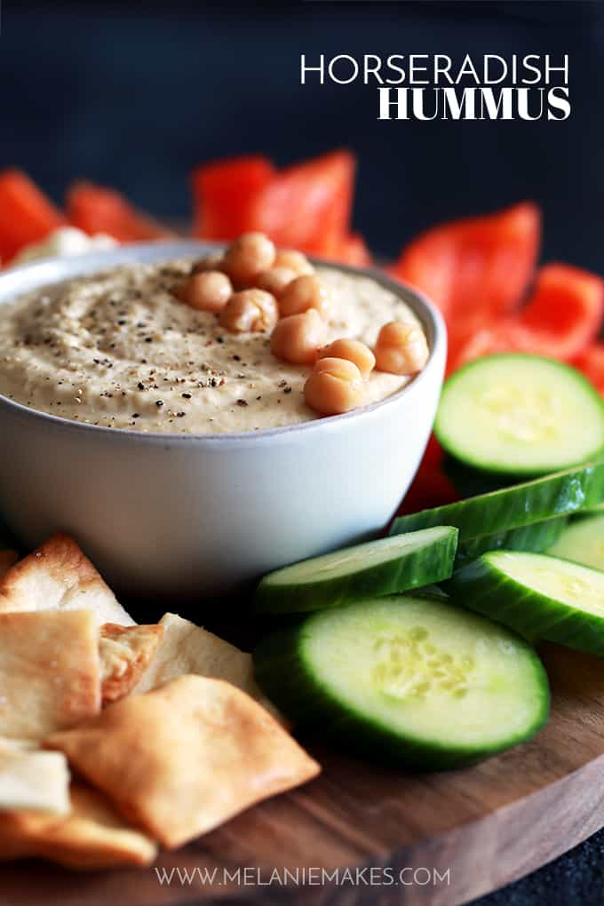 My five ingredient homemade Horseradish Hummus is so crazy easy, you'll never go the store-bought route again. Chickpeas, tahini, lemon juice, prepared horseradish and garlic are the stars of this snacking show. Everything goes into the food processor and then takes a quick whirl around until smooth.