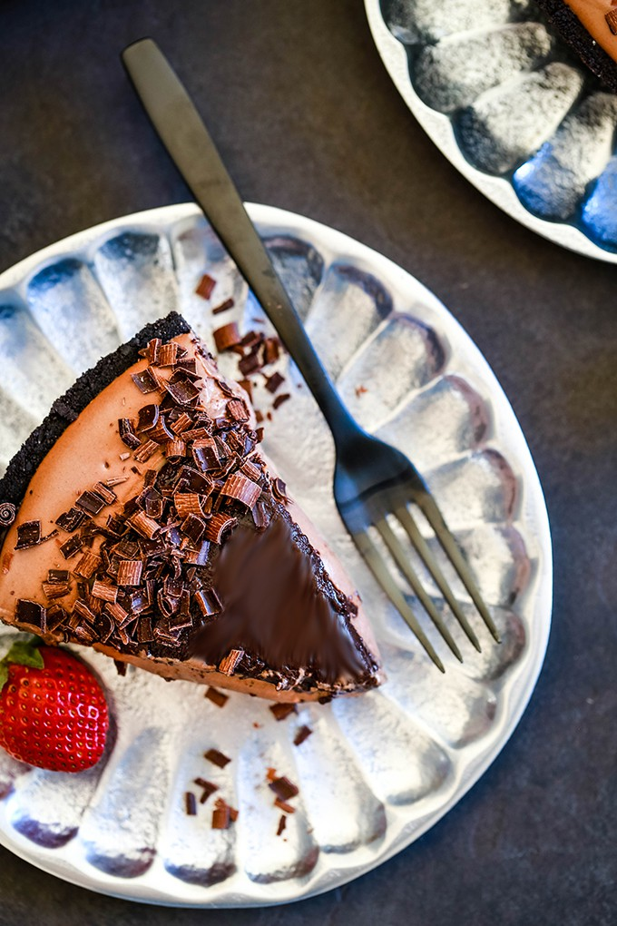 An overhead shot of a slice of No Bake Guinness Chocolate Cheesecake with a fork.