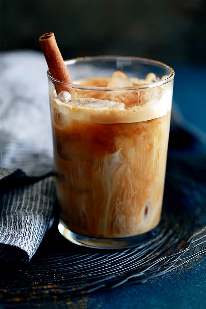 My four ingredient Iced Cinnamon Almond Milk Macchiato takes less than five minutes to create - so much faster than a trip to see your favorite barista!  Espresso, almond milk, cinnamon and caramel combine to create this amazing drink that tastes like you're sipping a cinnamon roll.
