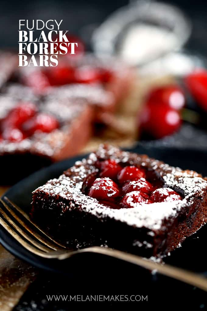 These Fudgy Black Forest Bars definitely have the rich chocolate flavor and moist, dense texture typical of fudge.  They're also the home of puddles of cherry pie filling and studded with dark chocolate chunks before being showered with powdered sugar.  The ultimate chocolate and cherry dessert combination.