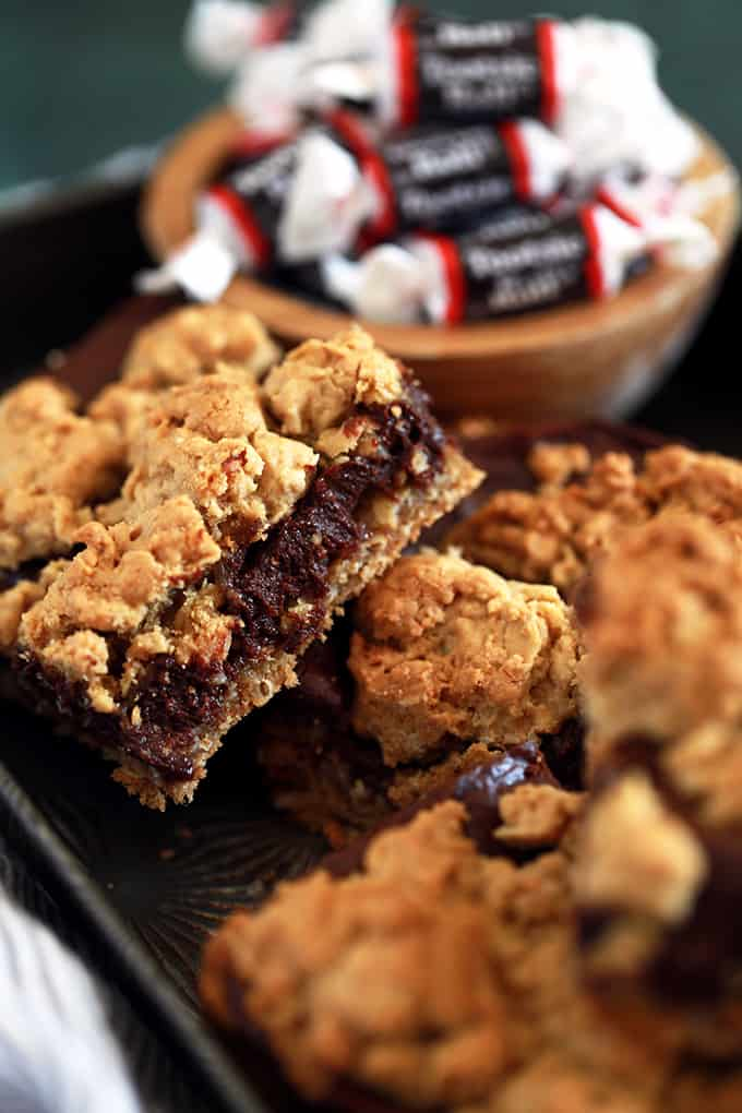 These Tootsie Roll Bars take just 15 minutes to prepare and are perfect for your next potluck, family gathering or holiday yet so delicious, you'll find yourself making them on a weekday just to get your fix! An oatmeal cookie type base is flooded with a fudgy Tootsie Roll like ganache that's then covered with additional dollops of the base mixture. Decadence at it's finest!