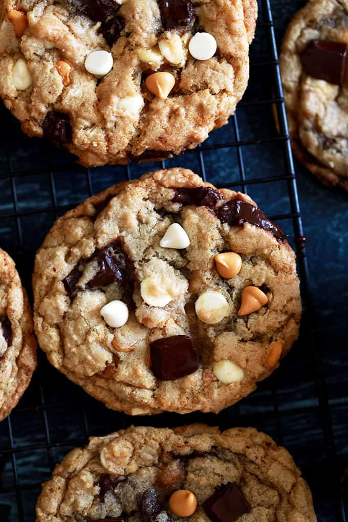 These large bakery style Triple Chip Cookies look like something you'd tell a barista to add to your usual morning drink order.  Soft and chewy in the middle and crisp around the edges, these cookies are loaded with dark chocolate chunks, white chocolate chips and butterscotch chips.