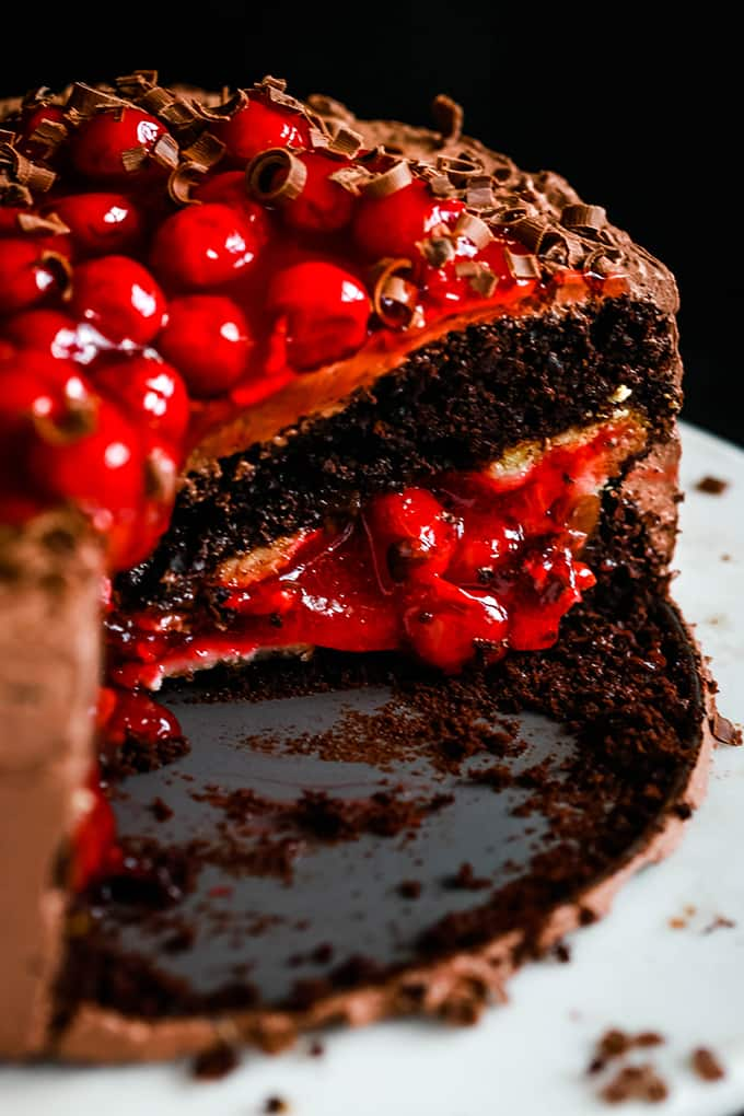 A Black Forest Piecaken with slices removed to reveal the interior of the cake.